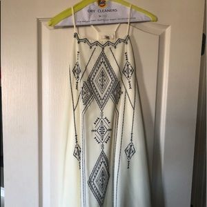 Off white thin strapped dress.